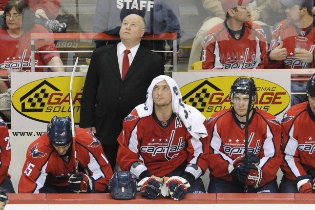 Washington Capitals head coach Bruce Boudreau stands behind Washington Capitals left wing Alex Ovechkin of Russia who has a towel on his head during the game against New York Rangers in the 2nd period at the Verizon Center in the NHL Eastern Conference Quarterfinals in Washington on April 15, 2009. The New York Rangers defeated the Washington Capitals 4-3 to take a 1-0 series lead. (UPI Photo/ Mark Goldman)