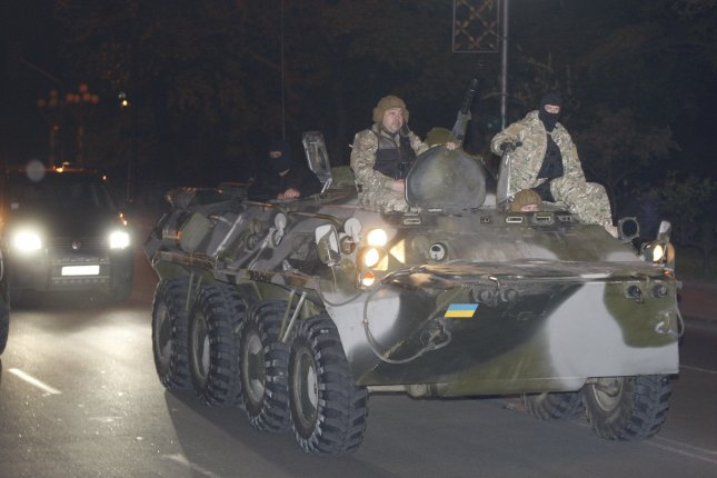 Russian media report gas lines in rebel-held eastern Ukraine were hit by Ukrainian artillery. Pictured, Ukrainian special forces participate in night exercises outside the parliament building in Kiev on May 1, 2014, to prepare for a possible Russian invasion as tensions escalate in eastern Ukraine. File photo by Ivan Vakolenko/UPI