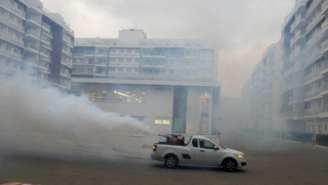 A car spraying for mosquitoes drives through the media village of the 2016 Summer Olympics in Rio de Janeiro, Brazil, on July 29. Brazil's Ministry of Health lifted the national state of emergency regarding the mosquito-borne Zika virus on Thursday, noting a drastic reduction in reported cases. Photo by Terry Schmitt/UPI