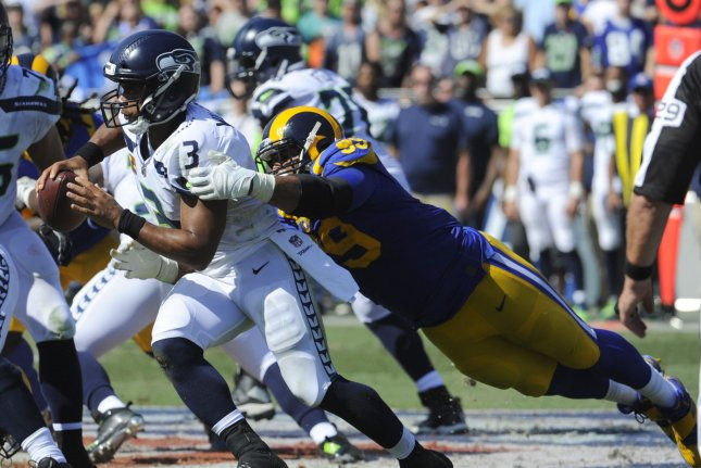 Los Angeles Rams defensive tackle Aaron Donald tackles Seattle Seahawks quarterback Russell Wilson in the first half at the Memorial Coliseum in Los Angeles, California on October 8, 2017. File photo by Lori Shepler/UPI