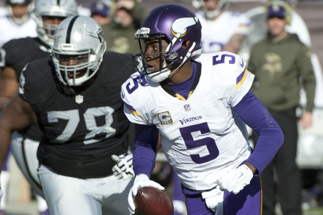 Minnesota Vikings quarterback Teddy Bridgewater (5) rolls out while being pursued by Oakland Raiders defensive lineman Justin Ellis (78) in the second quarter on November 15, 2015 at O.co Coliseum in Oakland, California. File photo by Terry Schmitt/UPI