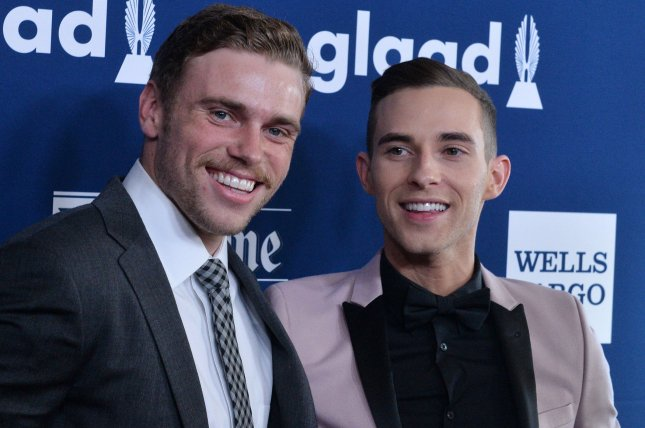 Olympic skier Gus Kenworthy (L) and Olympic figure skater Adam Rippon attend the GLAAD Media Awards on April 12. Photo by Jim Ruymen/UPI