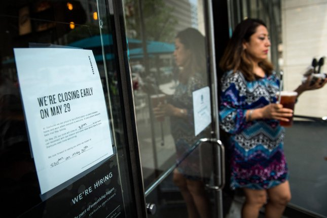 A sign is seen on a Starbucks coffee store widow announcing early closing, in Washington, D.C. on Tuesday. The coffee chain will close 8,000 stores nationwide today to conduct anti-bias training in the wake of an incident at a Philadelphia store where a store manager called the police on two African-American men who were quietly waiting for a friend. Photo by Kevin Dietsch/UPI
