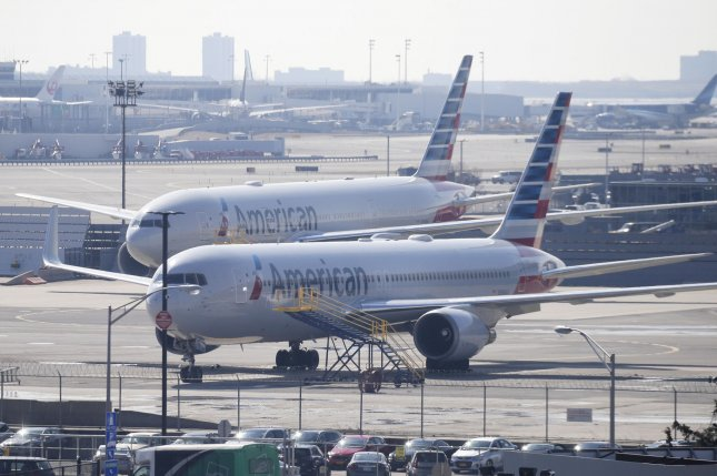 Planes from American Airlines sit on the tarmac at John K. Kennedy Airport last month. A downturn in transportation parts led to a decrease in new orders for durable good in February, according to the U.S. Census Bureau Tuesday. Photo by John Angelillo/UPI