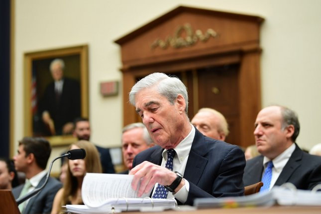 Former special counsel Robert Mueller examines his report during testimony of his investigation into Russian interference in the 2016 presidential election. It was at a House Judiciary Committee hearing on Capitol Hill on July 24. Photo by Kevin Dietsch/UPI