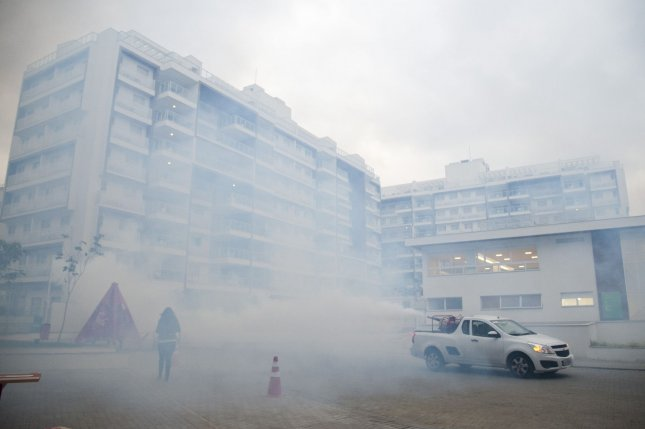 A car spraying for mosquitoes drives through the media village at dusk in Rio de Janeiro, Brazil, on July 29, 2016, during the 2016 Summer Olympics. One of the fears of the games was mosquito-bourne diseases such as zika and dengue fever. Photo by Kevin Dietsch/UPI
