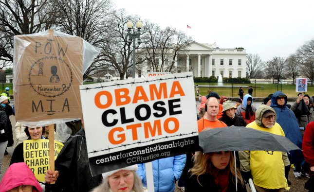 Protesters mark the 10th anniversary of the opening the Guantanamo Bay Detention Camp, in front of the White House in Washington Wednesday. Human-rights groups worldwide are demanding the camp be closed. Of the nearly 800 detainees taken to Guantanamo, 171 prisoners remain. UPI/Pat Benic