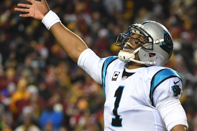 Carolina Panthers quarterback Cam Newton (1) celebrates after throwing a 30-yard touchdown pass to Ted Ginn Jr. against the Washington Redskins in the first quarter at FedEx Field in Landover, Maryland on December 19, 2016. Photo by Kevin Dietsch/UPI