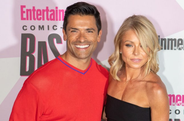 Kelly Ripa (R), pictured with Mark Consuelos, shared a picture of the actor with their sons and his dad. File Photo by Howard Shen/UPI
