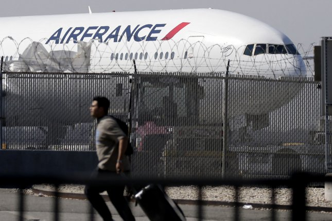 The Ivorian Coast Transport Ministry said it's investigating how a 15-year-old boy gained access to the undercarriage of an Air France flight before dying. File Photo by John Angelillo/UPI