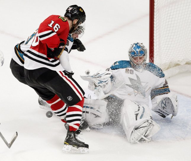 San Jose Sharks goalie Evgeni Nabokov (R) makes a save as Chicago Blackhawks left wing Andrew Ladd takes a shot during the second period of game 3 of the NHL Western Conference Finals at the United Center in Chicago. UPI/Brian Kersey