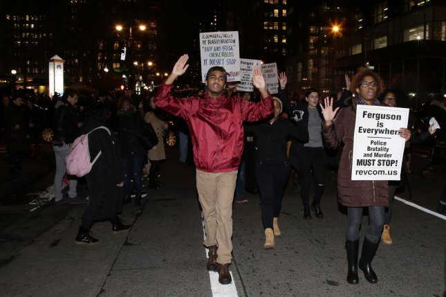 Protesters march up Sixth Avenue following a decision by a grand jury not to indict an NYPD officer involved in the apparent chokehold death of Eric Garner in New York City on December 3, 2014. Garner, a 43 year old father of six, died in July after police officers attempted to arrest him for allegedly selling loose, untaxed cigarettes in the Tompkinsville section of Staten Island. UPI/John Angelillo