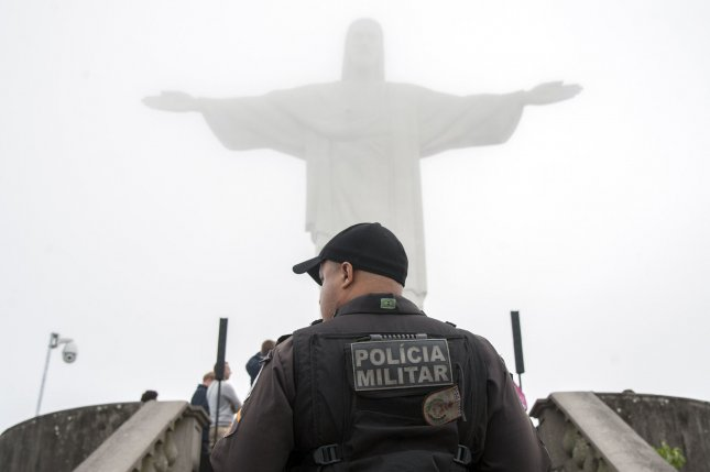 Brazil's Civil Police said officers made an unexpected rescue during a drug raid when they found a man they believe was held in captivity by his own family for more than 20 years. In this image, a police officer patrols at the Christ the Redeemer Statue, prior to the start of the 2016 Rio Summer Olympics in Rio De Janeiro, Brazil on August 3. File Photo by Kevin Dietsch/UPI