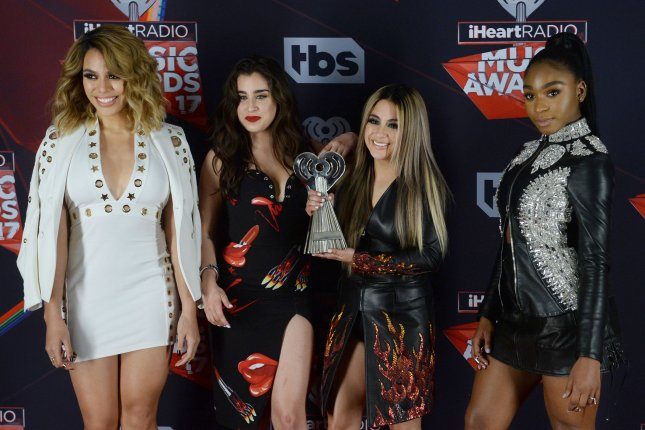 Normani Kordei (R) with Dinah Jane, Lauren Jauregui and Ally Brooke (L-R) of Fifth Harmony at the iHeartRadio Music Awards on March 5. File Photo by Jim Ruymen/UPI