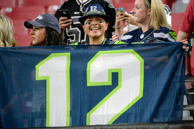 Seattle Seahawks fan holds up her twelfth man flag before the Seahawks-Arizona Cardinals game at University of Phoenix Stadium in Glendale, Arizona, October 23, 2016. Photo by Art Foxall/UPI