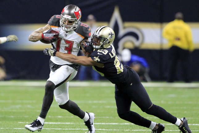 New Orleans Saints cornerback Marshon Lattimore (23) tackles Tampa Bay Buccaneers wide receiver Mike Evans (13) after a 13 yard gain at the Mercedes-Benz Superdome in New Orleans November 5, 2017. File photo by AJ Sisco/UPI