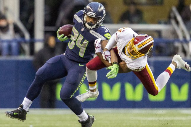 Washington Redskins cornerback Josh Norman (24) hangs onto Seattle Seahawks running back Thomas Rawls (34) as Rawls rushes for a 7-yard gain during the fourth quarter in their game on November 5 at CenturyLink Field in Seattle, Wash. Photo by Jim Bryant/UPI