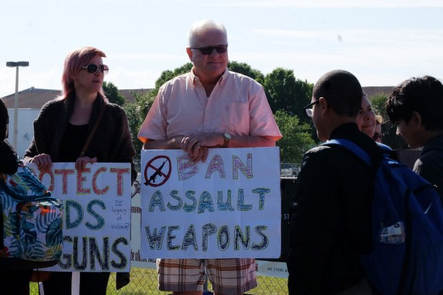Students and teachers from Marjory Stoneman Douglas High School Parkland, Fla., hold signs supporting an assault weapons ban like the one approved in Boulder, Colo., this week. File Photo by Gary Rothstein/UPI