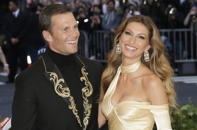 Gisele Bundchen (R), pictured with Tom Brady, dedicated a sweet post to the NFL star on his birthday. File Photo by John Angelillo/UPI