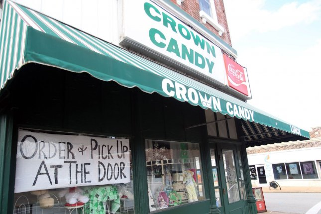 The popular Crown Candy Kitchen in St. Louis, Mo., reminds customers to order for curbside pickup on March 21, 2020. Many stores closed or shortened their hours because of the coronavirus fears. File Photo by Bill Greenblatt/UPI