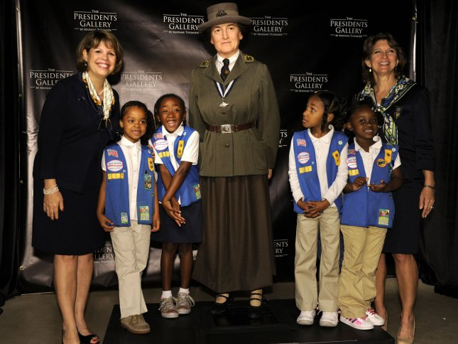 Girl Scout Council of the Nation's Capitol President Diane Tipton (L) and GSCNC CEO Lidia Soto-Harmon (R) pose with area Girl Scouts at the unveiling of the Madame Tussauds Museum's wax figure of Girl Scout founder Juliette Gordon Low, May 9, 2012, in Washington, DC. The Girl Scouts are celebrating the organization's 100th anniversary this year. UPI/Mike Theiler
