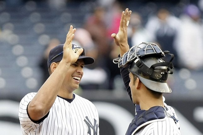Then-teammates New York Yankees Alex Rodriguez and Jorge Posada react after a game in New York in 2010. File Photo by John Angelillo/UPI
