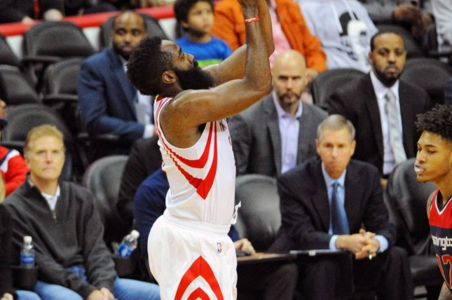 Houston Rockets guard James Harden (13) scores against the Washington Wizards in the first half at the Verizon Center in Washington, D.C. on November 7, 2016. Photo by Mark Goldman/UPI