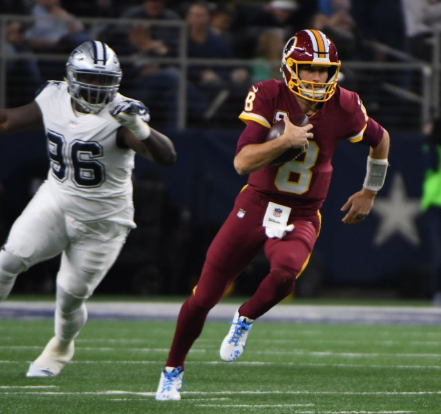 Washington Redskins quarterback Kirk Cousins scrambles in a game against the Dallas Cowboys in November. Photo by Ian Halperin/UPI