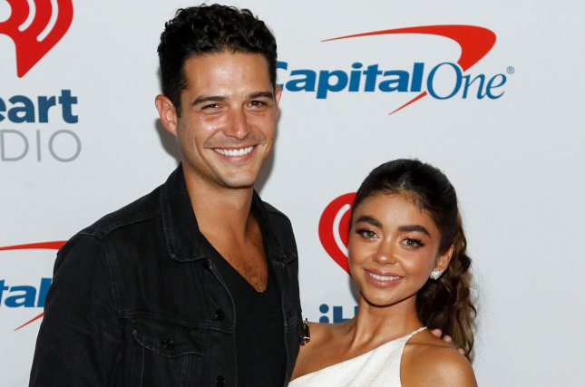 Sarah Hyland (R) and Wells Adams recalled their early relationship while celebrating their first anniversary as a couple. File Photo by James Atoa/UPI