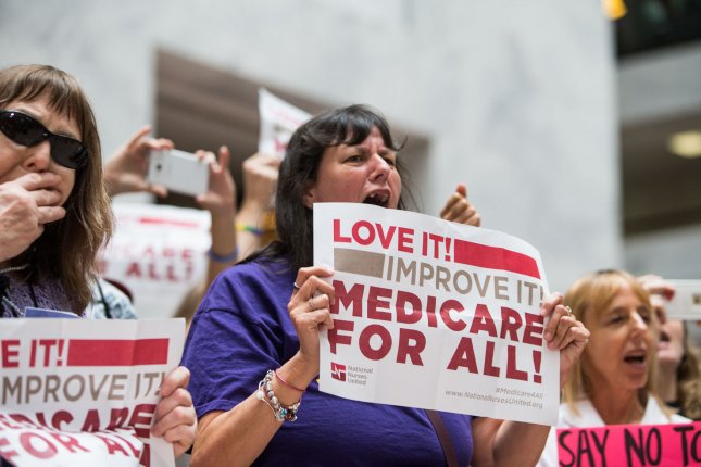 Activists protest a GOP healthcare bill on Capitol Hill in July 2017. On Wednesday, House Democrats unveiled legislation for a long-promised universal healthcare plan, commonly called Medicare for All. File Photo by Erin Schaff/UPI