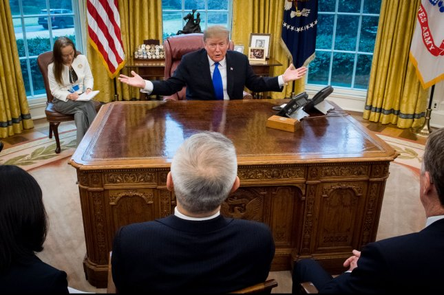 President Donald Trump meets with Chinese Vice Premier Liu He (C) in the Oval Office of the White House on February 22 for a discussion on China-United States trade. Photo by Kevin Dietsch/UPI