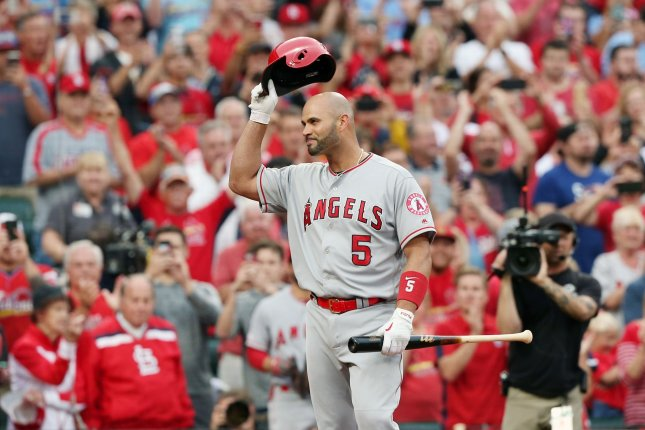 Los Angeles Angels slugger Albert Pujols tips his helmet to a standing ovation as he comes to bat in the first inning against the St. Louis Cardinals on Friday at Busch Stadium in St. Louis. Pujols is returning to St. Louis for the first time since leaving the team in 2011. Photo by Bill Greenblatt/UPI