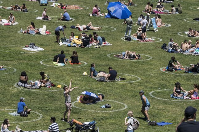 Groups hang out in pre-drawn circles in Delores Park in San Francisco on Saturday, May 23, 2020. Warm weather and a holiday weekend brought out thousands to practice their own brands of social distancing. Photo by Terry Schmitt/UPI