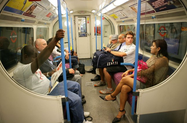 Nervous members of the public travel on a London Underground train the day after three small bombs exploded at different underground stations in London on Friday July 22 2005. (UPI Photo/Hugo Philpott)