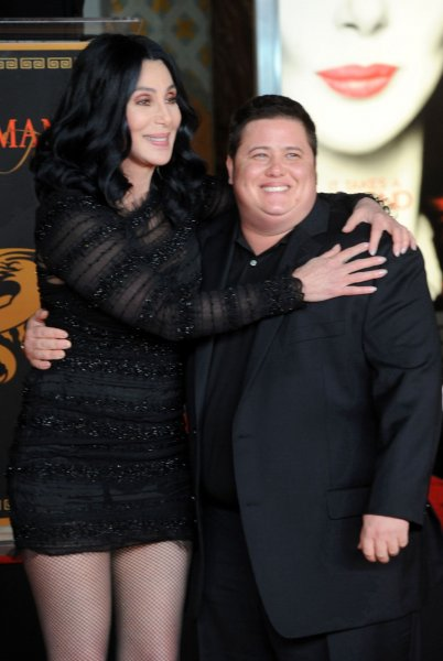 Cher poses with her son Chaz Bono after adding her hands and footprints to the famous impressions set in concrete, during a ceremony in the forecourt of the Grauman's Chinese Theatre in the Hollywood section of Los Angeles on November 18, 2010 UPI/Jim Ruymen
