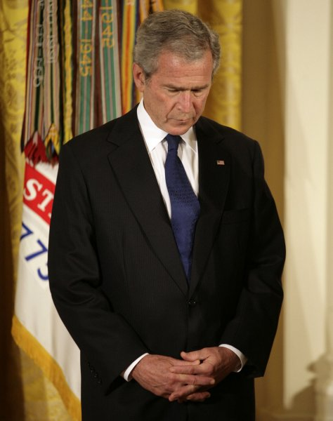 U.S. President George W. Bush stands during a prayer before awarding the Medal of Honor posthumously to the parents of U.S. Army PFC Ross McGinnis, of Knox, Pennsylvania, who was killed in Iraq in 2006, at the White House in Washington on June 2, 2008. (UPI Photo/Yuri Gripas)