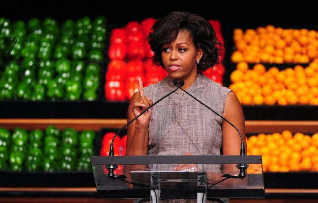 First Lady Michelle Obama speaks in front or a collection of fruits and vegetables as she announces her support for Walmat's new health initiative in Washington on January 20, 2011. Walmart has announced they will cut the fat, sugar and sodium in some packaged foods and will lower the price of fresh fruits and vegetables. UPI/Kevin Dietsch