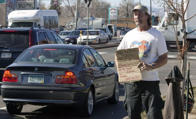 A family man and home owner still panhandles after only able to find work 2-3 days a week in Denver on November 6, 2009. Unemployment rates hit 10.2 percent, the first time it has surpassed 10 percent since 1983. UPI/Gary C. Caskey