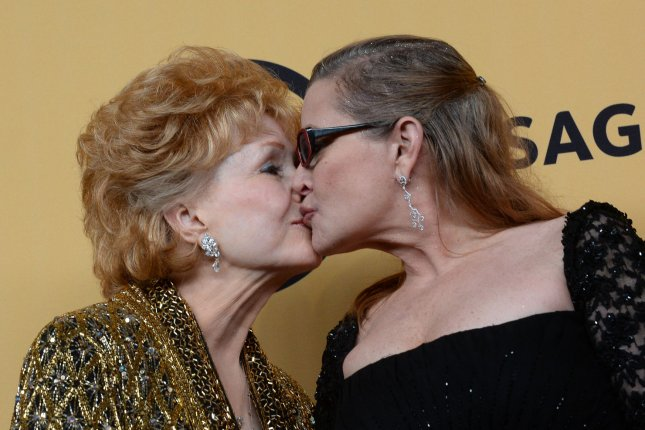 Debbie Reynolds (L), winner of the Screen Actors Guild lifetime award, and daughter Carrie Fisher pose backstage at the SAG Awards in Los Angeles in 2015. Fisher died Tuesday and her mother died Wednesday. File Photo by Jim Ruymen/UPI
