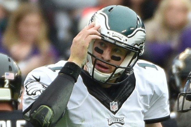 Philadelphia Eagles quarterback Carson Wentz (11) reacts after he was pushed out of bounds by Baltimore Ravens defenders during the first half of their NFL game on December 18 at M&T Bank Stadium in Baltimore, Md. Wentz helped a class get out of taking an exam by retweeting one of the students requesting his help. File photo by David Tulis/UPI