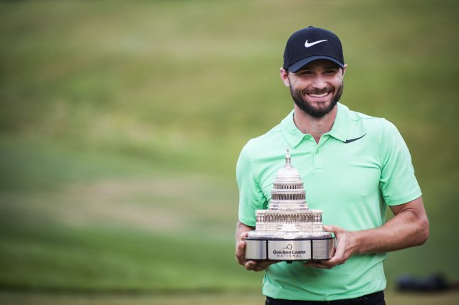 Kyle Stanley holds the trophy after he won the Quicken Loans National in July. Photo by Pete Marovich/UPI
