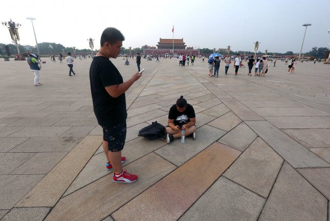People visit Tiananmen Square, the site of the deadly 1989 student protests, in Beijing on July 14. The death toll in the Chinese army crackdown on the 1989 Tiananmen Square protests was 10,000 people, according to newly released documents. Photo by Stephen Shaver/UPI