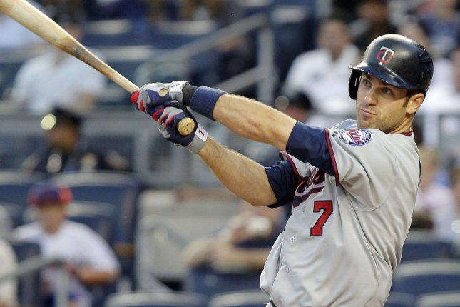 Joe Mauer and the Minnesota Twins face the Chicago White Sox on Friday. File photo by John Angelillo/UPI