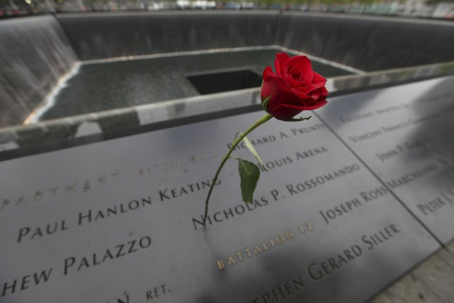 A rose is seen near the South reflecting pool at the National September 11 Memorial in New York City. File Photo by Allan Tannenbaum/UPI/Pool