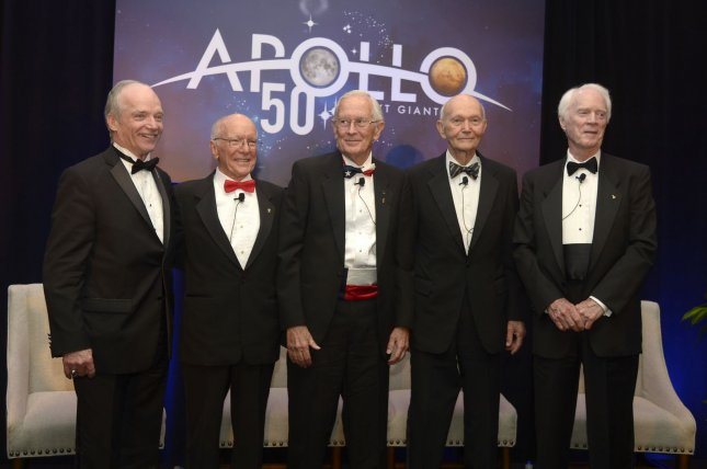 Shuttle astronaut Charlie Precourt, from left, the master of ceremonies; Gerry Griffin, flight controller; Charlie Duke, Apollo 16; Michael Collins, Apollo 11; and Rusty Schweikart, Apollo 9, attend a press conference to provide their thoughts on the Apollo missions, as well as the future of the manned space program, during the Apollo 50th Gala in Cocoa Beach, Fla., on Tuesday. Photo by Joe Marino/UPI