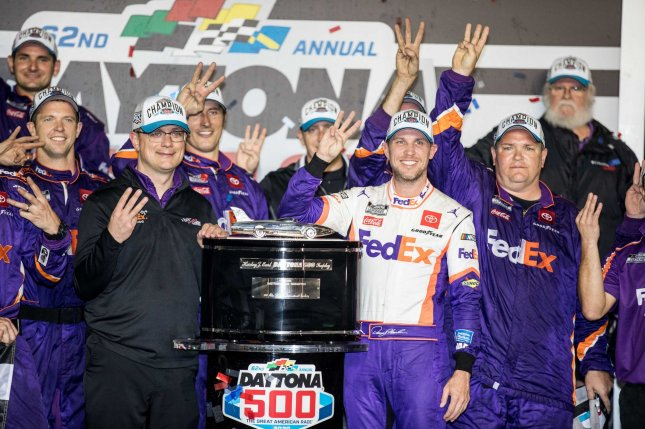 Denny Hamlin celebrates with his crew after winning the 62nd annual Daytona 500 on Monday night at Daytona International Speedway in Daytona Beach, Fla. It marked his third win at the race. Photo by Edwin Locke/UPI