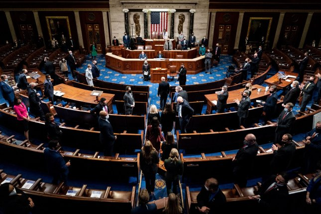 Electoral college votes are brought in before House Speaker Nancy Pelosi and Vice President Mike Pence resume presiding over a joint session of Congress to count the Electoral College results on Capitol Hill in Washington, D.C., on Wednesday. Pool photo by Erin Schaff/UPI