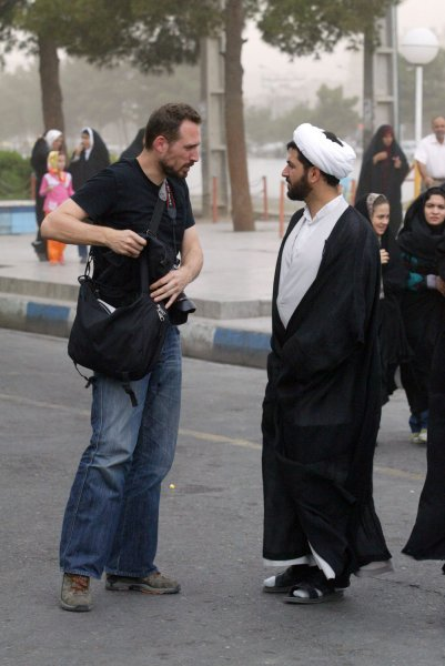 Greek national Iason Athanasiadis (L), seen on June 12, 2009 in Qom city, was arrested on June 20, 2009 in Tehran, and charged with