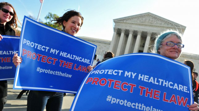 Supporters gather in front of the U.S. Supreme Court as the court hears it's third day of arguments on the constitutionality of President Obama's health care bill in Washington, D.C. on March 28, 2012. UPI/Kevin Dietsch