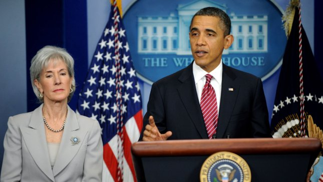 U.S. President Barack Obama announces a compromise and says the administration will not require religious institutions to pay for birth control for their employees, during remarks in the Brady Press Room at the White House in Washington DC on February 10, 2012. At left is Health and Human Services Secretary Kathleen Sebelius, a member of the Catholic Church. UPI/Pat Benic...